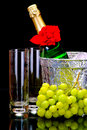 Champagne flutes in ice bucket, glasses and grape Royalty Free Stock Photo