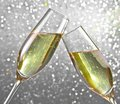 Champagne flutes on silver light bokeh background make cheers Stock Photos