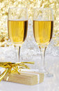 Champagne with a gift Royalty Free Stock Photography