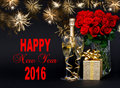 Champagne, gift, flowers and golden fireworks. Happy New Year 20 Royalty Free Stock Photo