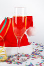 Champagne glass and christmas hat, with ribbons, confetti Stock Photography