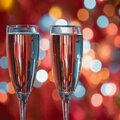 Champagne glass close up on Christmas and New Year holiday bokeh background Royalty Free Stock Photo