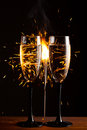 Champagne glasses against sparkler background christmas Royalty Free Stock Photography