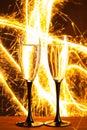 Champagne glasses against sparkler background christmas Stock Images