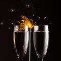 Champagne glasses against sparkler background christmas Stock Photos