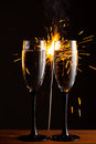 Champagne glasses against sparkler background christmas Royalty Free Stock Image