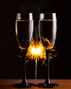 Champagne glasses against sparkler background christmas Stock Photography