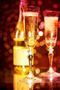Champagne glasses and bottle Stock Images