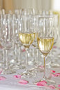 Champagne and glasses at celebrations on roses Royalty Free Stock Photography