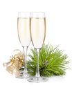 Champagne glasses and christmas bells Royalty Free Stock Photography