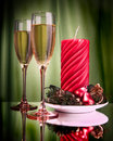 Champagne glasses and Christmas candle Royalty Free Stock Photos