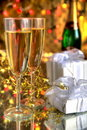 Champagne in glasses, gift box and lights Stock Photography