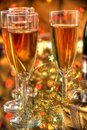 Champagne in glasses,gift box and lights Royalty Free Stock Photos