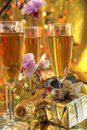 Champagne in glasses,gift and flowers Stock Images