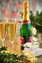 Champagne in glasses and green twig Stock Image