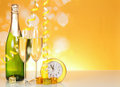 Champagne glasses hours on an abstract yellow background Stock Image