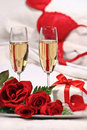 Champagne glasses and roses to celebrate valentine s day Royalty Free Stock Image