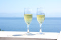 Champagne glasses with sea background Royalty Free Stock Photo