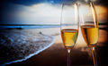 Champagne glasses on tropical beach - exotic New Year Royalty Free Stock Photo