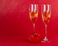 Champagne goblets with jeweller box on red Stock Photos