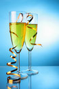 Champagne with gold streamer Royalty Free Stock Photography