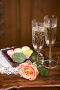 Champagne with macaroons two glasses of sparkling wine or small colorful Stock Photos