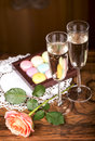 Champagne with macaroons two glasses of sparkling wine or small colorful Royalty Free Stock Image
