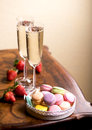 Champagne with macaroons two glasses of sparkling wine or small colorful Stock Image