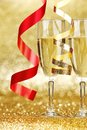 Champagne and ribbons new year on golden background Royalty Free Stock Photos