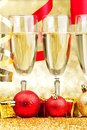Champagne and ribbons new year on golden background Stock Photos