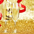 Champagne and ribbons new year on golden background Stock Photography