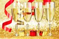 Champagne and ribbons new year on golden background Royalty Free Stock Photography