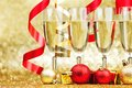 Champagne and ribbons new year on golden background Royalty Free Stock Photo
