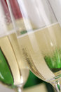 Champagne or sparkling wine with bubbles in a glass bottle the background Royalty Free Stock Image