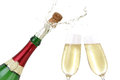 Champagne splashing out of the bottle with a popping cork Royalty Free Stock Photography