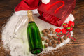 Champagne still life on table bottle of surrounded by a christmas Stock Image