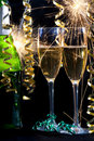 Champagne, two glasses and sparklers. Royalty Free Stock Photos