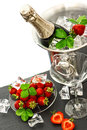 Champagne and two glasses, strawberries. Festive arrangement Royalty Free Stock Photo