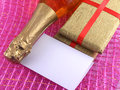 Champagne or wine bottle blank paper and golden box new year or christmas card empty Royalty Free Stock Image