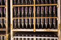 Champagne wine going through secondary fermentation process plant cellar with bottles kept for Royalty Free Stock Photos