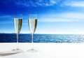 Champaign glasses and ocean open Stock Photos