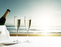 Champaign Glasses and sunset on beach Royalty Free Stock Photo