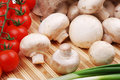 Champignons, tomatoes and onion on a mat Stock Image