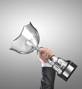 Champion businessman holding a silver trophy Royalty Free Stock Photography