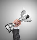 Champion businessman holding a silver trophy Stock Photo