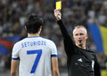 Champions league steaua bucharest dinamo tbilisi the icelandic fifa referee kristinn jakobsson shows a yellow card during the Royalty Free Stock Photo