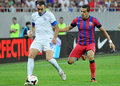 Champions league steaua bucharest dinamo tbilisi s daniel georgievski r and s david kvirkvelia l pictured in action before the Royalty Free Stock Photos