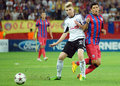 Champions league steaua bucharest legia warsaw s dominik furman and s cristian tanase pictured in action during the uefa play offs Royalty Free Stock Photos