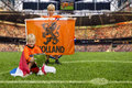 Champions two young boys in the middle of a huge stadium with dutch flags and a big trophy Royalty Free Stock Photos