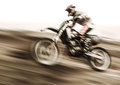 Championship of motocross side view of sportsmen driving motorcycle slow motion speed highway extreme lifestyle Royalty Free Stock Images